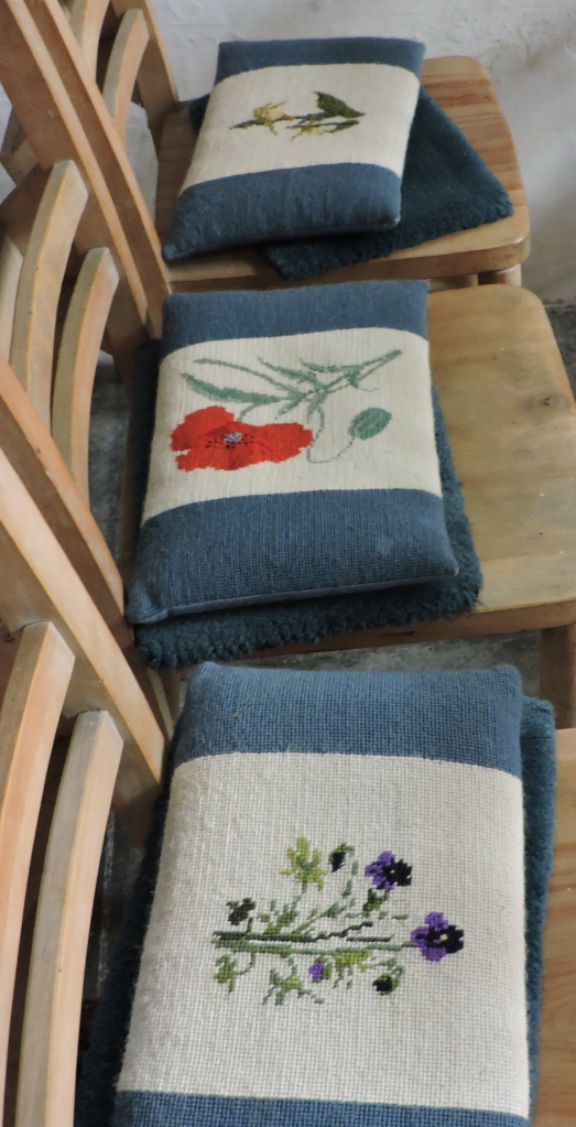 A selection of the kneelers from the Lady Chapel - embroidered with wild flowers